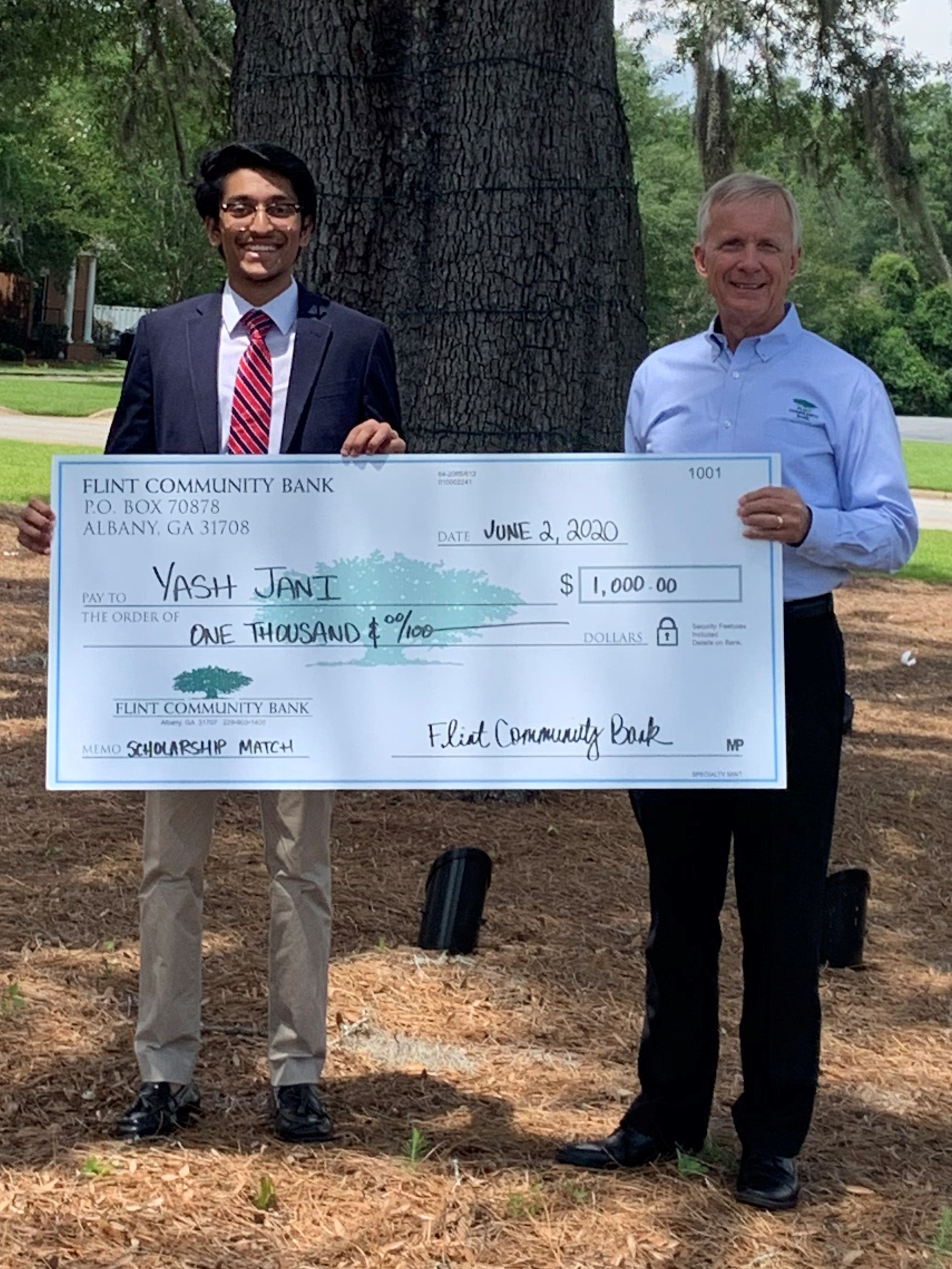 Yash Jani accepting scholarship funds